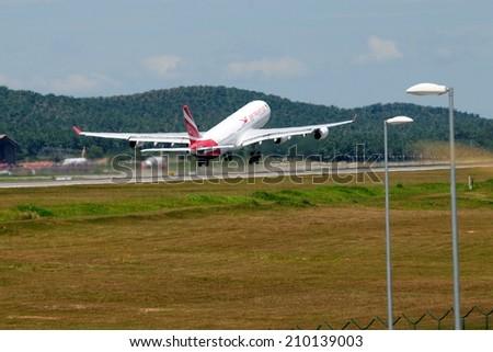 SEPANG, MALAYSIA - AUGUST 5: Air Mauritius plane Airbus A340-300, Registration name 3B-NBE, take-off at KLIA airport on August 5, 2014 in KLIA, Sepang, Malaysia.  - stock photo