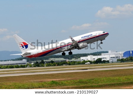 SEPANG, MALAYSIA - AUGUST 5: Malaysia Airline plane Boeing 737-800, Registration name 9M-FFD, take-off at KLIA airport on August 5, 2014 in KLIA, Sepang, Malaysia.  - stock photo