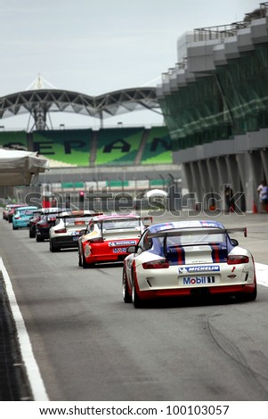 SEPANG, MALAYSIA - DECEMBER 5: Cars making their way to the main track for warm up sesion during the MHH Super Series Round 5 on December 5, 2009 in Sepang, Malaysia - stock photo