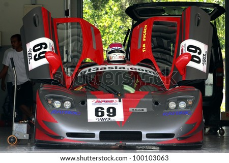 SEPANG, MALAYSIA - DECEMBER 5: GT3asia.com race car parked in the garage during the MHH Super Series Round 5 on December 5, 2009 in Sepang, Malaysia - stock photo