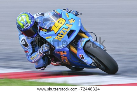 SEPANG, MALAYSIA-FEB 24: Alvaro Bautista of Rizla Suzuki MotoGP at MotoGP Official Test Sepang 2 on Feb 24, 2011 in Sepang, Malaysia. - stock photo