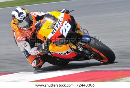 SEPANG, MALAYSIA-FEB 24: Dani Pedrosa of Repsol Honda Team at MotoGP Official Test Sepang 2 on Feb 24, 2011 in Sepang, Malaysia. - stock photo