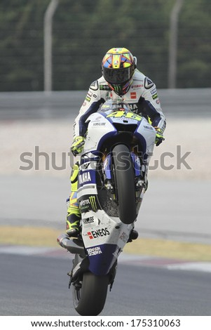 SEPANG, MALAYSIA-FEB 6, 2014: Italian nine Grand Prix World Championships of Italy No. 46 Valentino Rossi of Yamaha Factory Racing at MotoGP Official Test Sepang 1 in Sepang, Malaysia. - stock photo
