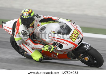 SEPANG, MALAYSIA-FEB 7: Italy No. 29 Andrea Iannone of Energy T.I. Pramac Racing Team at MotoGP Official Test Sepang 1 on Feb 7, 2013 in Sepang, Malaysia. Season 2013 will start in Qatar on April 7. - stock photo