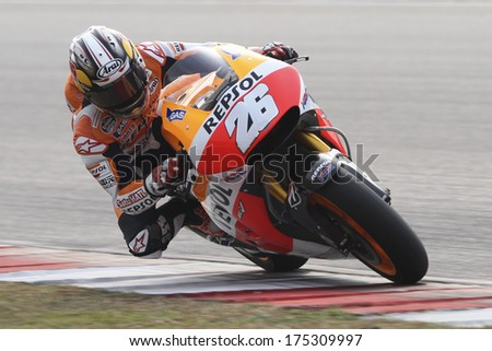 SEPANG, MALAYSIA-FEB 6, 2014: Spanish MotoGP rider Dani Pedrosa of Spain no. 26 Repsol Honda Team at MotoGP Official Test Sepang 1 in Sepang, Malaysia. - stock photo