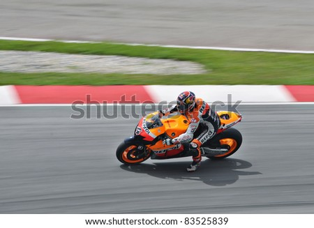 SEPANG, MALAYSIA - FEBRUARY 3: Andrea Dovizioso from Repsol Honda Team during Moto GP Pre-Season Test Day 3 on February 3, 2011 at Sepang International Circuit in Sepang, Malaysia - stock photo