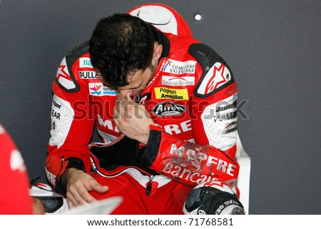 SEPANG, MALAYSIA - FEBRUARY 22: Hector Barbera of Aspar Ducati Team reacts after a crash during practice at the 2011 MotoGP winter test in Sepang International Circuit. on February 22, 2011 in Malaysia. - stock photo