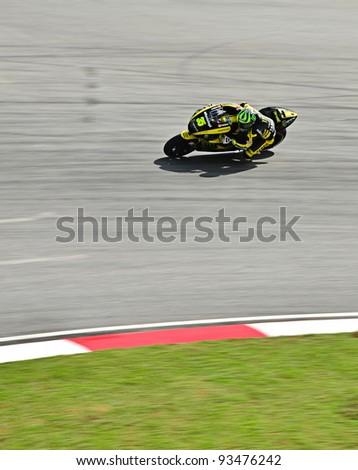SEPANG, MALAYSIA - FEBRUARY 3: Moto GP Cal Crutch low from Monster Yamaha Tech 3 Mo to GP Team during MotoGP Test Day at Sepang International Circuit on October 21, 2011 in Sepang, Malaysia. - stock photo