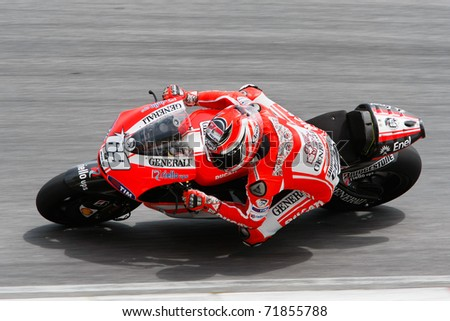 SEPANG, MALAYSIA - FEBRUARY 23: MotoGP rider Nicky Hayden of Ducati Malboro Team practices at the 2011 MotoGP winter tests at the Sepang International Circuit. February 23, 2011 in Malaysia. - stock photo