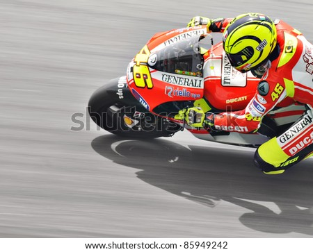 SEPANG, MALAYSIA - FEBRUARY 3: Valentino Rossi from Ducati Team during MotoGP Pre-Season Test Day 3 on February 3, 2011 at Sepang International Circuit, Malaysia - stock photo
