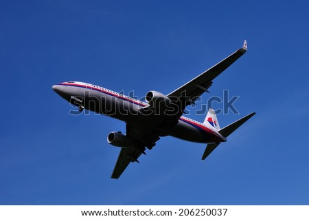 SEPANG, MALAYSIA - JULY 19: Malaysia Airlines plane Boeing 737-8FZ, Registration name 9M-MLF, ready to landing at KLIA airport on July 19, 2014 in KLIA, Sepang, Malaysia.  - stock photo
