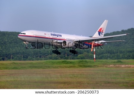SEPANG, MALAYSIA - JULY 19: Malaysia Airlines plane Boeing 777-2H6ER, Registration name 9M-MRQ, landing at KLIA airport on July 19, 2014 in KLIA, Sepang, Malaysia.  - stock photo
