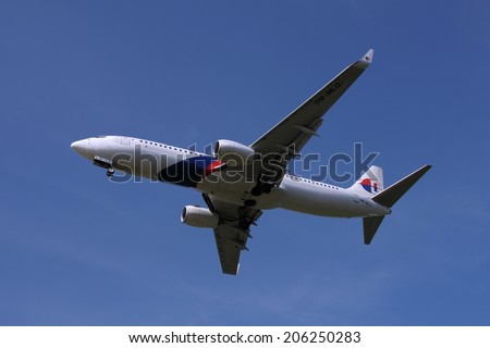 SEPANG, MALAYSIA - JULY 19: Malaysia Airlines plane Boeing 737-8H6(WL), Registration name 9M-MLQ, ready to landing at KLIA airport on July 19, 2014 in KLIA, Sepang, Malaysia.  - stock photo