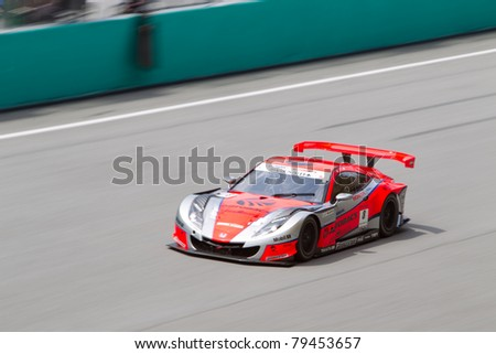 SEPANG, MALAYSIA - JUNE 18: Autobacs Racing Team Aguri in their Honda goes past the pit lane during qualifying at Super GT International series June 18, 2011 in Sepang, Malaysia - stock photo