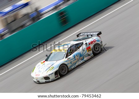SEPANG, MALAYSIA - JUNE 18: Team LMP Motorsports in their Ferrari f430 going past the pit lane during qualifying at Super GT International series June 18, 2011 in Sepang, Malaysia - stock photo