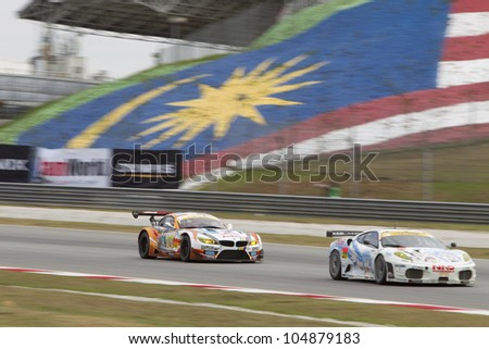 SEPANG, MALAYSIA - JUNE 10: Team Ukyo in their BMW chases Team LMP in their Ferrari car at Super GT Race June 10, 2012 in Sepang, Malaysia - stock photo