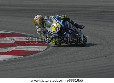 SEPANG, MALAYSIA - KUALA LUMPUR, MALAYSIA - FEBRUARY 4: Valentino Rossi of Italy at the MotoGP pre-season testing on February 4, 2010 at the Sepang International Circuit near Kuala Lumpur, Malaysia. - stock photo