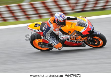 SEPANG,MALAYSIA-MARCH 1:Australian Casey Stoner of Repsol Honda Team at 2012 MotoGP Official Winter Test Sepang 2 on Mar. 1, 2012 in Sepang, Malaysia. The 2012 MotoGP season starts on April 8 in Qatar. - stock photo