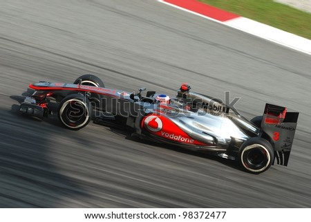 SEPANG, MALAYSIA - MARCH 24: British Jenson Button of McLaren-Mercedes in action during qualifying session at Petronas Formula 1 Grand Prix on March 24, 2012 in Sepang, Malaysia - stock photo