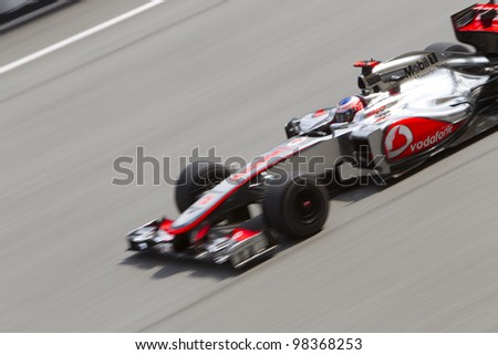 SEPANG, MALAYSIA - MARCH 23: British Jenson Button of Team McLaren drives down the main straight during Friday practice at Petronas Formula 1 Grand Prix March 23, 2012 in Sepang, Malaysia - stock photo