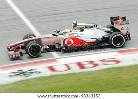 SEPANG, MALAYSIA - MARCH 24: British Lewis Hamilton of McLaren-Mercedes taking corner during third practice session at Petronas Formula 1 Grand Prix on March 24, 2012 in Sepang, Malaysia - stock photo