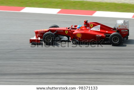 SEPANG, MALAYSIA - MARCH 23 : Ferrari Team driver Felipe Massa in action on track during Petronas Malaysian Grand Prix second practice session at Sepang F1 circuit on March 23, 2012 in Sepang, Malaysia. - stock photo