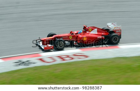 SEPANG, MALAYSIA - MARCH 23 : Ferrari Team driver Fernando Alonso in action during Petronas Malaysian Grand Prix second practice session at Sepang F1 circuit March 23, 2012 in Sepang - stock photo