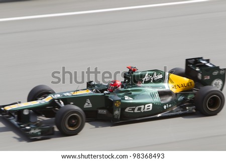 SEPANG, MALAYSIA - MARCH 23: Finnish Heikki Kovalainen of Team Caterham down the main straight during Friday practice at Petronas Formula 1 Grand Prix March 23, 2012 in Sepang, Malaysia - stock photo