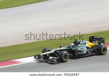 SEPANG, MALAYSIA - MARCH 23: Finnish Russian Vitaly Petrov exits turn 15 during Friday practice at Petronas Formula 1 Grand Prix March 23, 2012 in Sepang, Malaysia - stock photo