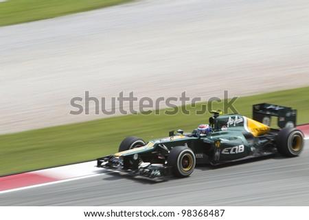 SEPANG, MALAYSIA - MARCH 23: Finnish Russian Vitaly Petrov exits turn 15 during Friday practice at Petronas Formula 1 Grand Prix March 23, 2012 in Sepang, Malaysia - stock photo