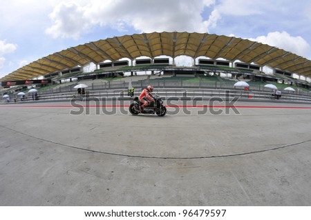 SEPANG,MALAYSIA-MARCH 1:Fisheye effect of Nicky Hayden of Ducati Team at 2012 MotoGP Official Winter Test Sepang 2 on Mar. 1, 2012 in Sepang, Malaysia.The 2012 MotoGP season starts on April 8 in Qatar - stock photo