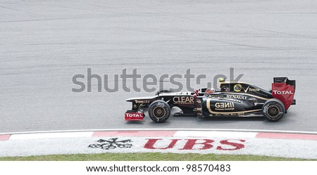 SEPANG, MALAYSIA-MARCH 23 : Formula One driver Romain Grosjean of Lotus F1 team races during the first practice session on March 23, 2012 at Sepang International Circuit in Sepang, Malaysia. - stock photo