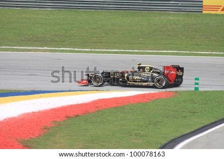 SEPANG, MALAYSIA - MARCH 23: French Romain Grosjean of Lotus-Renault in action during Friday practice at Petronas Formula 1 Grand Prix on March 23, 2012 in Sepang, Malaysia - stock photo