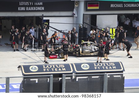 SEPANG, MALAYSIA - MARCH 23: French Romain Grosjean of Team Lotus does a trial pit during Friday practice at Petronas Formula 1 Grand Prix March 23, 2012 in Sepang, Malaysia - stock photo
