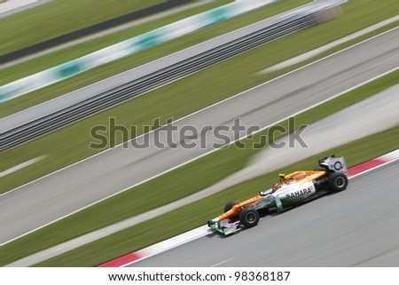 SEPANG, MALAYSIA - MARCH 23: German Nico Hulkenberg of Team Sahara Force India exits turn 15 during Friday practice at Petronas Formula 1 Grand Prix March 23, 2012 in Sepang, Malaysia - stock photo