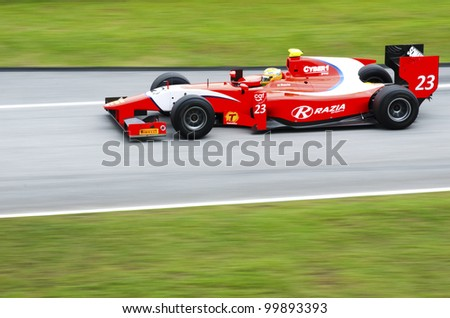 SEPANG, MALAYSIA-MARCH 23 : GP 2 series driver Luiz Razia  of Arden International team races during the first practice session on March 23, 2012 at Sepang International Circuit in Sepang, Malaysia. - stock photo
