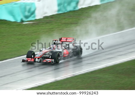 SEPANG,MALAYSIA-MARCH 25: Jenson Button of McLaren team in action in rain-hit Formula One PETRONAS Malaysian Grand Prix at Sepang F1 Circuit on March 25,2012 in Sepang, Malaysia. Alonso won the race. - stock photo