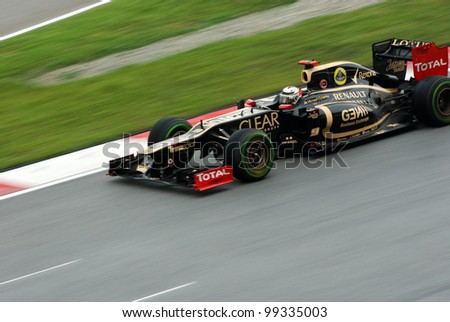 SEPANG, MALAYSIA - MARCH 25: Lotus-Renault F1 Team driver Kimi Raikkonen in action during race day of Petronas F1 Malaysian Grand Prix at Sepang Circuit on March 25, 2012 in Sepang, Malaysia - stock photo