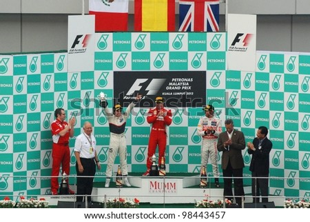 SEPANG, MALAYSIA - MARCH 25: 2nd place Sergio Perez of Sauber-Ferrari Team holding the trophy on podium at Sepang International Circuit on March 25, 2012 in Sepang, Malaysia - stock photo