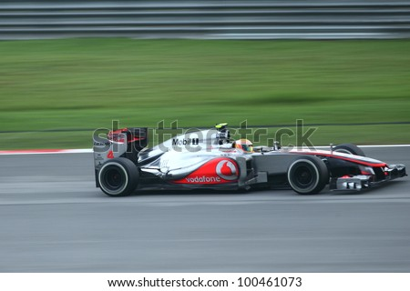 SEPANG,MALAYSIA-MARCH 25: Panning shot of Lewis Hamilton from McLaren team  during the race day of Formula One PETRONAS Malaysian Grand Prix at Sepang F1 Circuit on March 25,2012 in Sepang, Malaysia - stock photo