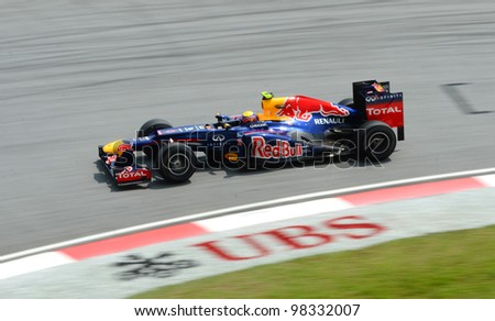 SEPANG, MALAYSIA -MARCH 23 : Red Bull Racing-Renault Team driver Mark Webber action on track during Petronas Malaysian Grand Prix second practice session at Sepang F1 circuit March 23, 2012 in Sepang - stock photo