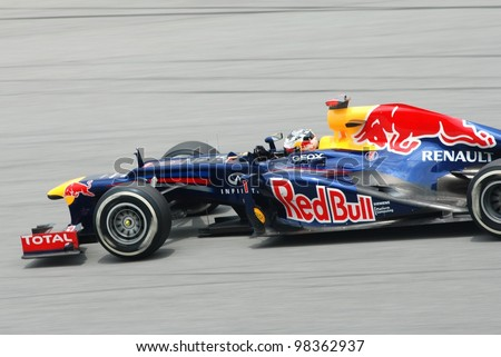 SEPANG, MALAYSIA -MARCH 24 : Red Bull Racing-Renault Team driver Sebastian Vettel in action during Petronas F1 Grand Prix third practice session at Sepang F1 circuit on March 24, 2012 in Sepang - stock photo