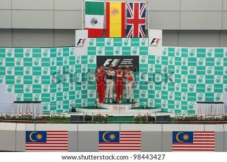 SEPANG, MALAYSIA - MARCH 25: Winners of Formula 1 Petronas Malaysian Grand Prix at the podium at Sepang International Circuit on March 25, 2012 in Sepang, Malaysia - stock photo