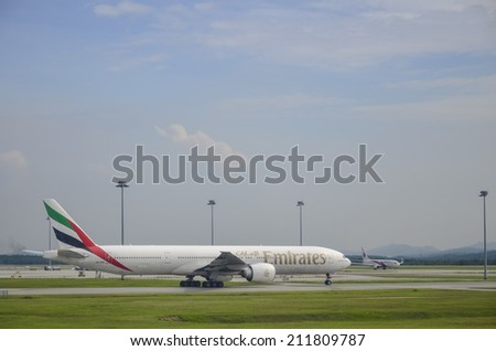 SEPANG, MALAYSIA - MAY 8: Emirates plane, Boeing 777-31H(ER), Registration name A6-ECY, ready to landing at KLIA airport on May 8, 2014 in KLIA, Sepang, Malaysia. - stock photo