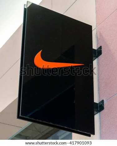 SEPANG, MALAYSIA - MAY 8, 2016: Nike logo. Nike is one of famous sports fashion brands worldwide and it is one of the world's largest suppliers of athletic shoes and apparel. - stock photo