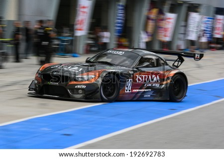 SEPANG, MALAYSIA - MAY 10, 2014: The BMW car of Morris Chen and Tatsuya Tanigawa returns to the pit lane after the free practice session of the Malaysian Super Series Round 2 in Sepang Circuit. - stock photo