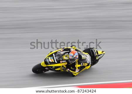 SEPANG, MALAYSIA-OCT.21:Colin Edwards in action during practice session of Shell Advance Malaysian Moto GrandPrix on Oct 21 2011 in Sepang, Malaysia.The MotoGP class race will be held on Oct. 23, 2011 - stock photo