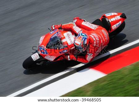 SEPANG, MALAYSIA - OCTOBER 23: Casey Stoner (AUS) during Practice day of MotoGP in Malaysian Grand Prix on October 23, 2009 in Sepang, Malaysia. - stock photo