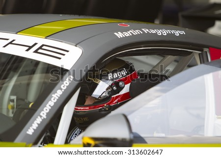 Sepang, Malaysia - September 5, 2015 : Austrian Martin Ragginger of Team Porsche Holding in deep concentration at Porsche Carrera Cup Asia AFOS, Sepang, Malaysia  - stock photo