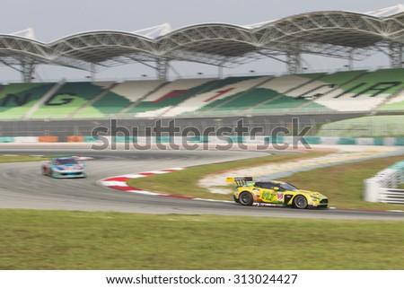 Sepang, Malaysia - September 4, 2015 : British Aston Martin car no 99 exits turn 2 at Asian Festival of Speed Race, Sepang, Malaysia  - stock photo